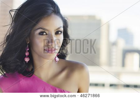 Beautiful young woman with city background