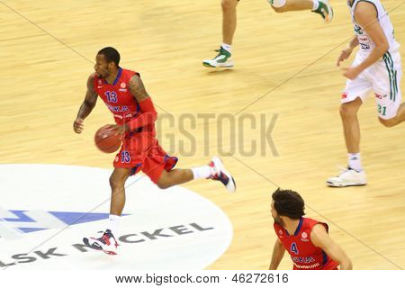 MOSCOW - SEP 29: Sportsman from CSKA Moscow (Russia, in red) teams dribbles basketball game in tournament for cup named Gomelsky in CSKA sports center, on Sep 29, 2012 in Moscow, Russia.
