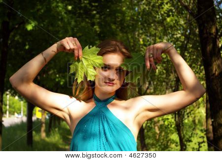 Woman Holds Maple Leaves
