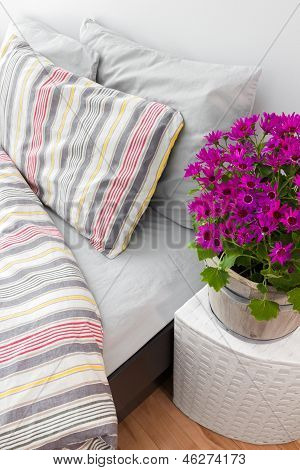 Bright Purple Flowers Decorating A Bedroom