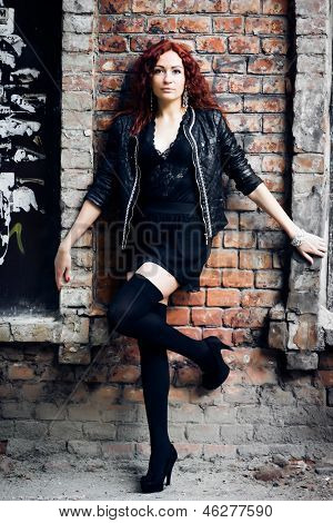 girl on the old red brick wall