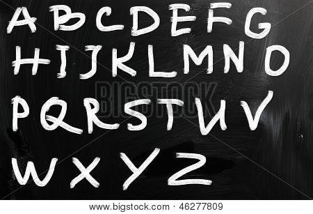 English Alphabet Handwritten With White Chalk On A Blackboard
