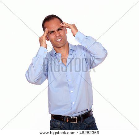 Hispanic Man With Headache Holding His Forehead