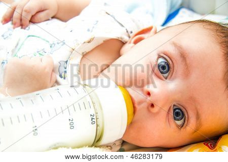 Baby And Milk Bottle