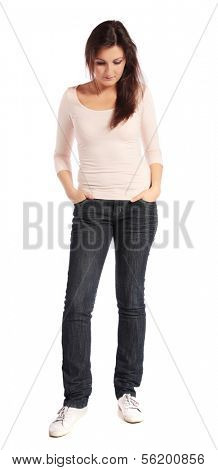 Attractive young woman looking to the ground. All isolated on white background.