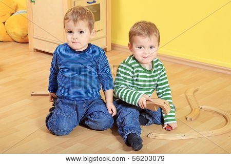 Cute european toddlers in kindergarten.