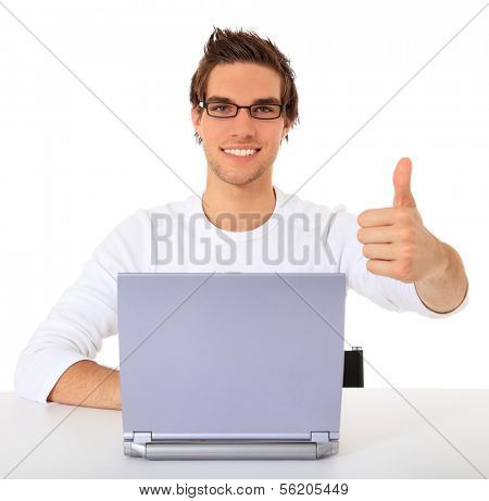 Smiling young guy using notebook computer. All on white background.