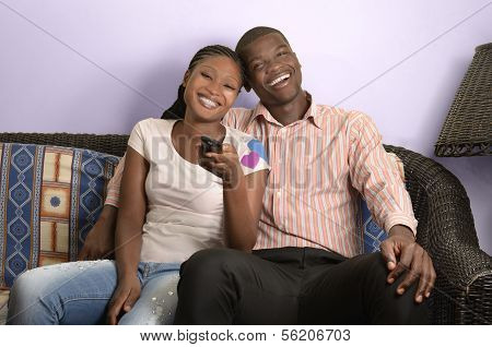 Young African Couple On Sofa