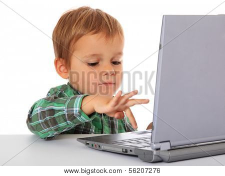Cute caucasian boy using laptop. All on white background.