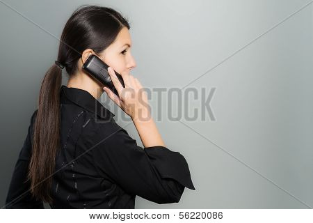 Secretive Businesswoman Talking On Her Mobile