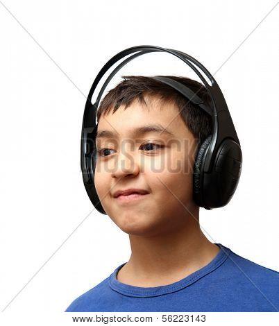 boy listening music in wireless headphones