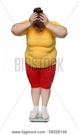women with overweight standing on scales isolated on white