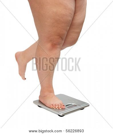 women legs with overweight standing on scales