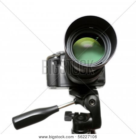 DSLR camera on tripod isolated over white