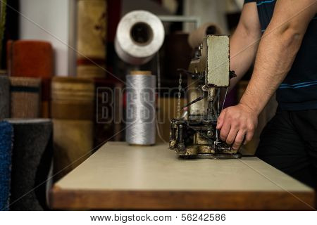 Young Man Carpet Maker Using Sewing machine poster