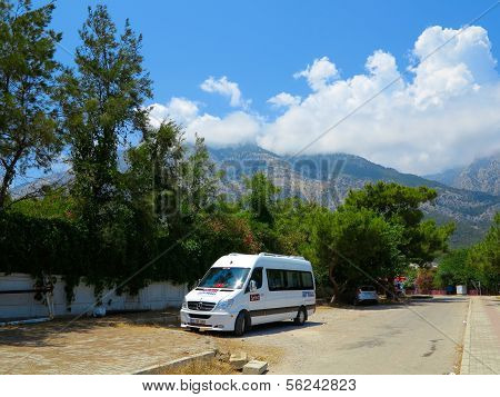 Minibus Parked On The Background Of Mountains