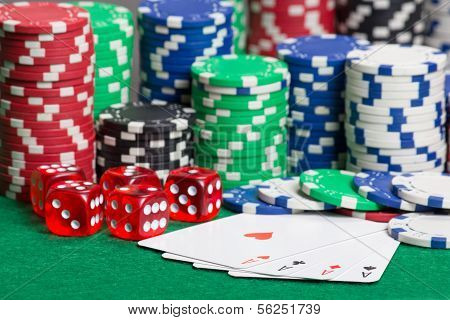 dice four aces and colorful poker chips on a green table poster
