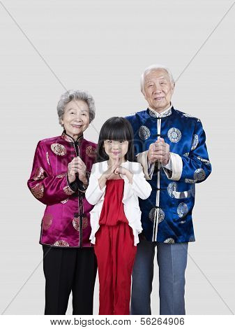 Senior Couple And Granddaughter