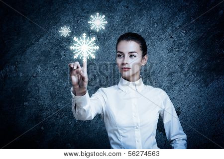 Woman Pointing at Glowing Snow Icon