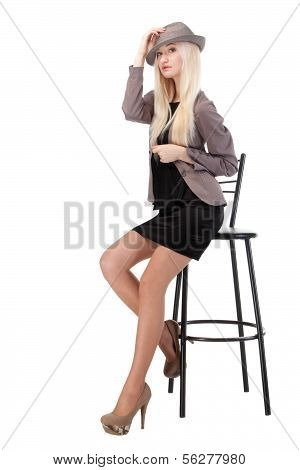 Attractive Woman Sitting On Bar Chair