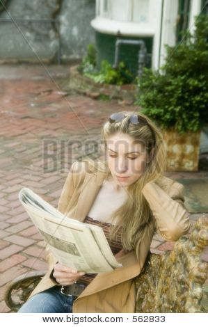 Blonde Woman Reading Newspaper