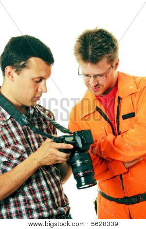 Photographer Shows Shots On Camera To Model - Worker