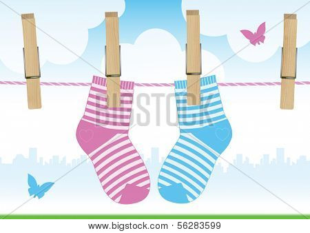 Vector illustration of a clothesline with clothespins and baby socks.