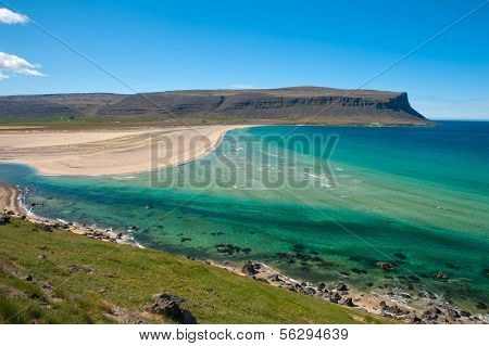 Extremely beautiful bay with mighty golden beaches and turquise sea in the West Fjords, Iceland.