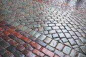 Background texture of wet granite cobblestone urban road poster