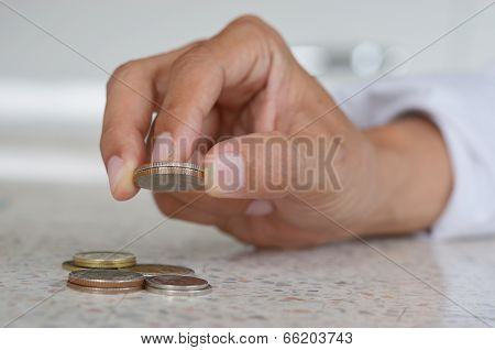 Man's Hand, Holding 2 Coin