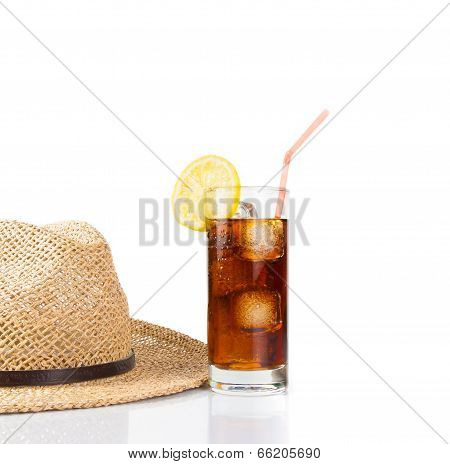 Glass Of Fresh Coke With Straw Near Summer Hat, Summer Time