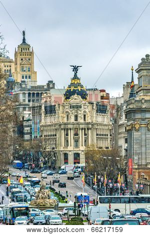 Madrid, Spain - February 13, 2014: Cars Passing On The Gran Via, Just Before The Famous Metropolis B