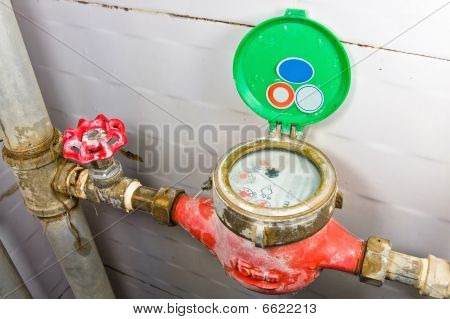 Old Rusty Brass Valve With Tubes And Water Meter.