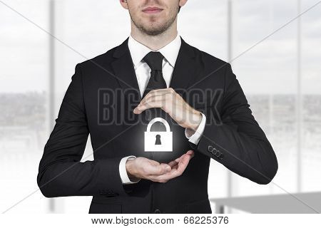 businessman protecting lock symbol