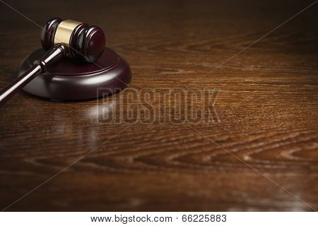 Dark Wooden Gavel Abstract on Table with Room for Text.