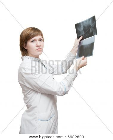 Woman doctor looking at x-ray isolated over white poster