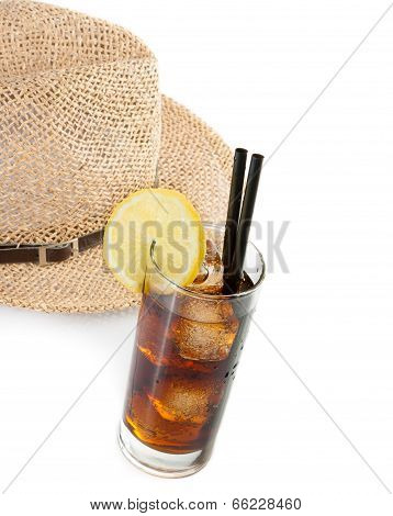 Glass Of Fresh Coke With Straw In Front Of Summer Hat, Summer Time