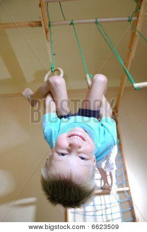 Boy Hanging On Gymnastic Rings