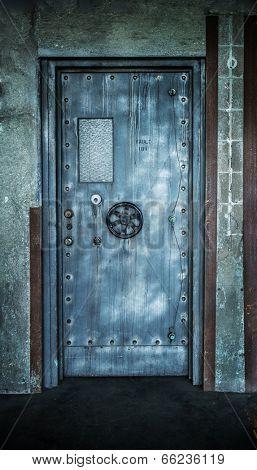 Grunge style image of old metal door background with vault lock.