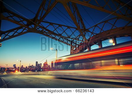 Los Angeles city at night. Long exposure shot of blurred bus speeding through iconic 6th Street Bridge