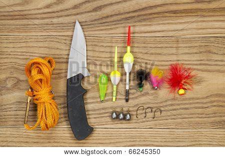 Fishing Kit On Aged Wood