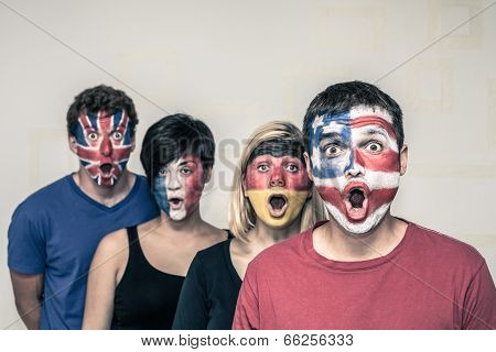 Surprised People With Flags On Faces