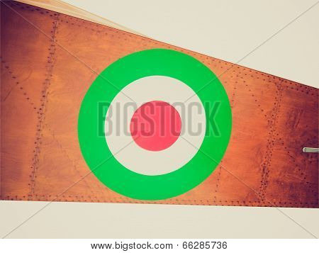 Vintage retro looking Flag of the Italian Air Force Aeronautica Militare on an old plane poster