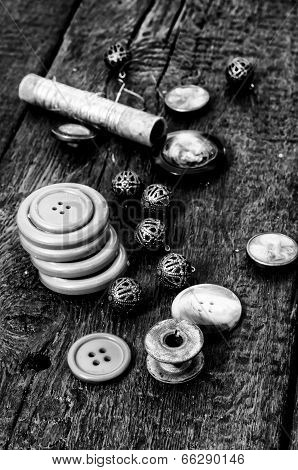 different buttons and zipper on the background of sewing tool