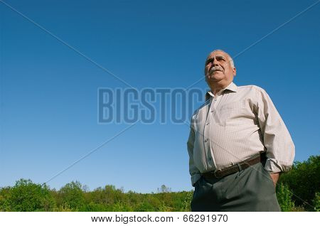 Low Angle View Of An Overweight Senior Man