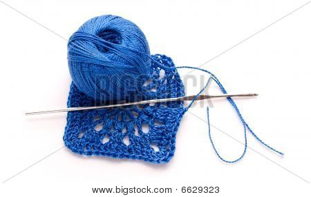 A Ball Of Blue Yarn With Knitting And Crochet Pattern Crochet
