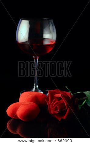 Wine Glass And A Red Rose