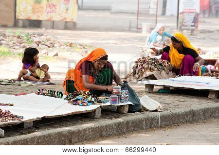 Indian Women In Sari And Their Children Sells Souvenirs