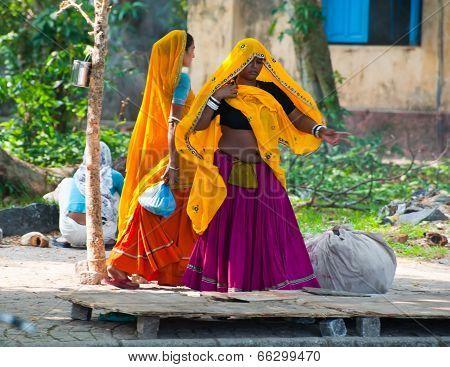 Indian women in colorful sari at city street