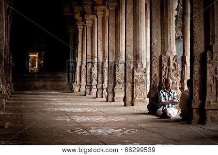 Indian People Pilgrim Resting Inside Ancient Colonnade Of Meenakshi Temple